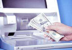 An ATM withdrawal from a checking account may immediately reduce a person's available balance.