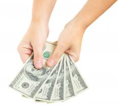 Cash can be deposited into a checking or savings account at a bank.