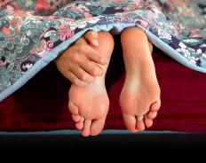 Plantar fasciitis and heel spurs often cause feet to hurt in the morning.