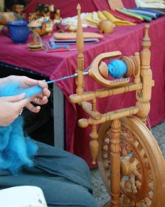 A spinning wheel is commonly used to spin fibers like wool.