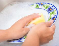 Manually washing dishes can cause dry skin patches on hands.