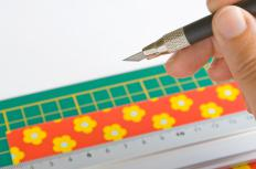 Scrapbook, wrapping or wall paper may be cut to size and rolled to form a lamp shade.