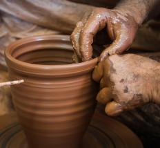 Handmade porcelain pottery is often created on a wheel.