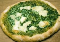 Pesto can be used instead of red sauce on a vegetarian pizza.