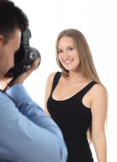 A photographer apprentice may be responsible for creating the stage and correct lighting for a photo shoot.