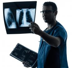 Physicians examinine chest radiographs before to determine if a patient's pleura has been compromised.