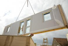 The sections of a modular house might only require a few weeks to build.