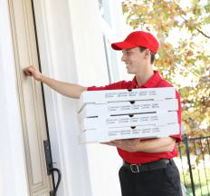 A man delivers deep dish pizzas.