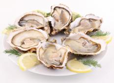 Some shellfish, like oysters, are commonly raised through aquaculture.