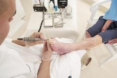 A podiatry assistant performs care on people's feet.