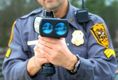 Law enforcement officers ensure that speed limits are adhered to by drivers.