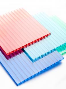 Sheets of colored polycarbonate, a thermoplastic polymer.