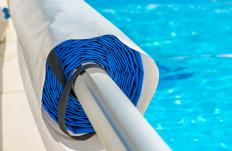 A motorized pool tarp is a good way to protect a pool from debris.