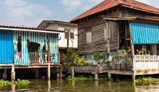 Thai houses are often placed on stilts to protect them from flooding.