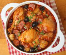 Chicken cacciatore is flavored with oregano, garlic, and basil.