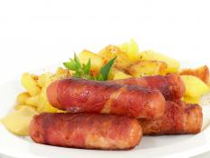 Potatoes and sausage are included in a breakfast platter.