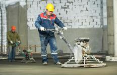 Power trowels are used to impart a smooth surface finish on freshly poured concrete slabs.