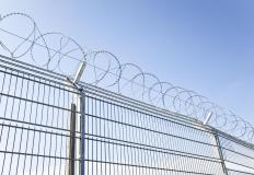 Barbed wire fences, which are used for security or agricultural purposes, consist of wire strung with barbs.