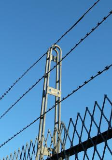 Deployed with cable placed in fences, piezoelectric film has been used in high-security settings, such as prisons.