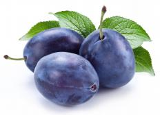 Freshly-picked plums are used to create plum preserves.