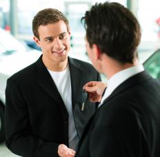 A car salesman selling a car.