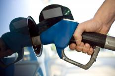 A man filling up his gas tank. Gasoline is a form of chemical energy.