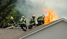 An adjuster may inspect damage done to a house during a fire to make assessments of the expenses involved in repair.