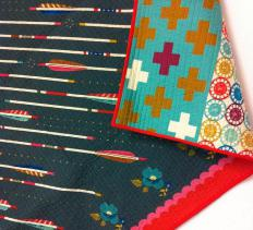 A quilt table runner may be simple or complex in design and could feature a wide range of quilted blocks or just squares of different fabrics sewn together.
