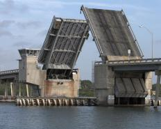 Folding bridges can be raised to allow ships to pass underneath.
