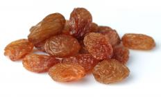 Raisins are typically included in recipes for cougnou.