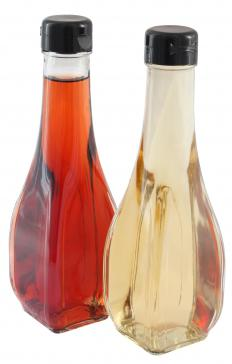Red wine vinegar beside white wine vinegar.