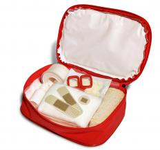 A first aid kit contains bandages,  antiseptic, and basic medications.