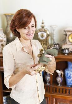 Reviewing similar items at antique stores can provide insight into how much antique furniture might be worth.