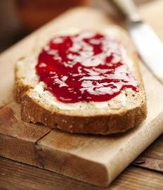 Different kinds of jams are usually spread on fairy bread.