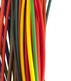 Plastic extrusion is used in the production of wire insulation.