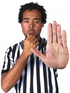 A football official may use hand signals to indicate a ruling.