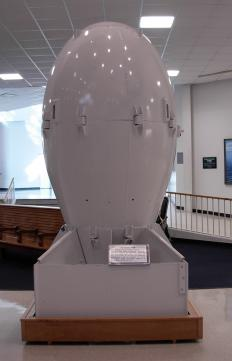 "A replica of the ""Fat Man"" atom bomb in a museum."