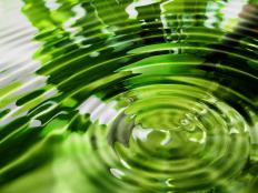 A series of ripples is caused by a single act of throwing a pebble into a pond.