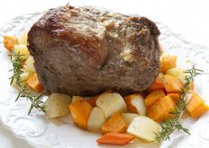 Slow cooker pot roast is often cooked with vegetables to add moisture and flavor to the meat.