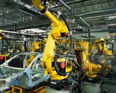 Robots working on an automobile assembly line.