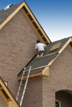 A roofing hoist makes it easier to install shingles on a steep roof.