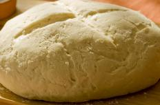 The most basic type of dough for French bread contains water, flour, salt and a starter or dried yeast.