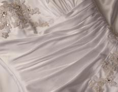 A close up of a wedding dress.