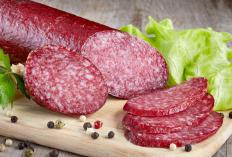Ground meat is stuffed into a casing to make salami.