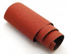 Sandpaper can be used to distress furniture.