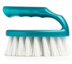 A scrub brush and oxygen bleach can be used to clean a deck.
