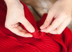 A person sewing.