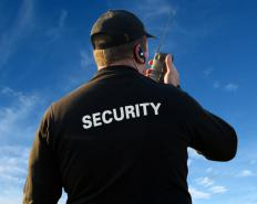 A security guard wears a uniform clearly demonstrating he is charged with defending property on behalf of someone else.