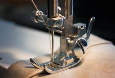 The presser foot holds fabric in place on a sewing machine.