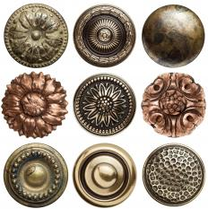 Fire gilding is traditionally used for buttons.